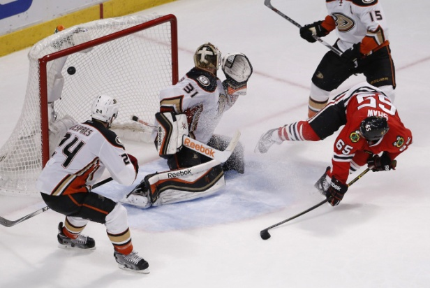 Chicago Blackhawks center Andrew Shaw (65) watches his shot score against Anaheim Ducks goalie Frederik Andersen (31) during the third period in Game 6 of the Western Conference finals of the NHL hockey Stanley Cup playoffs, Wednesday, May 27, 2015, in Chicago. The Blackhawks won 5-2. (AP Photo/Charles Rex Arbogast)
