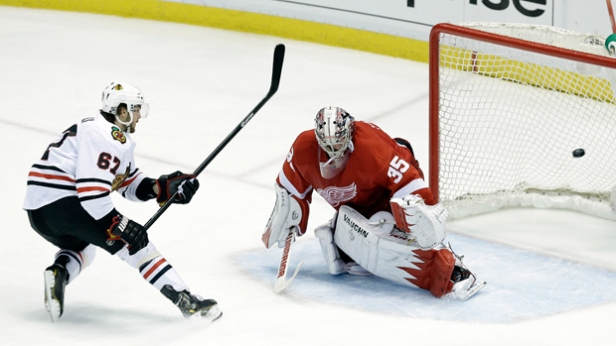 Michael Frolik beats Jimmy Howard on a penalty shot to give the Blackhawks a 4-2 third period lead in Game 6.